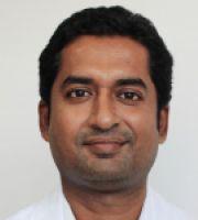 Dr. Kiran R